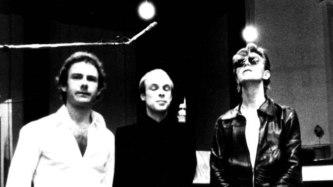 "Guitarist Robert Fripp, producer Brian Eno and artist David Bowie line up for a photo at Hansa studios in West Berlin while recording ""Heroes"" in 1977."