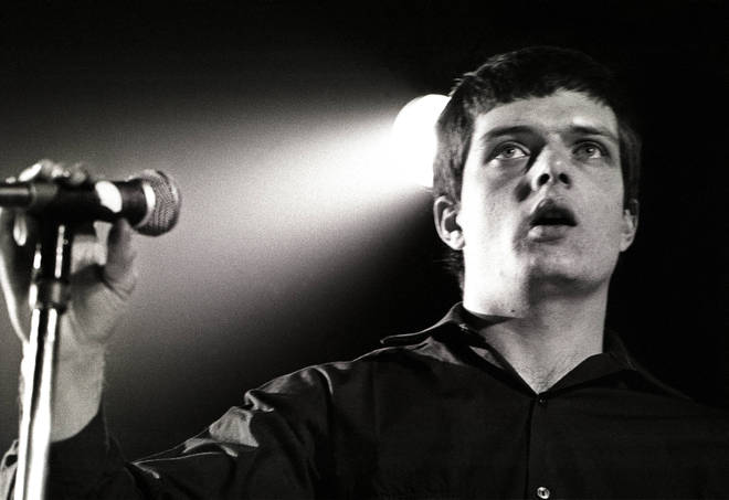 Ian Curtis performing live onstage with Joy Division in January 1980