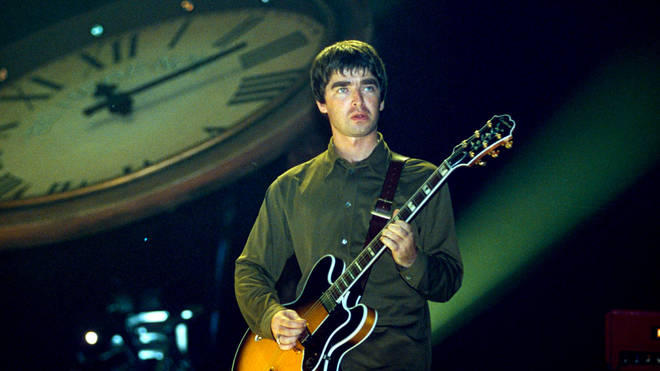 Noel Gallagher performing with Oasis at Earls Court in 1997