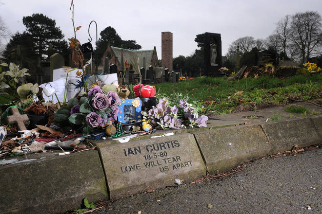 The memorial stone for Ian Curtis at Macclesfield Cemetery