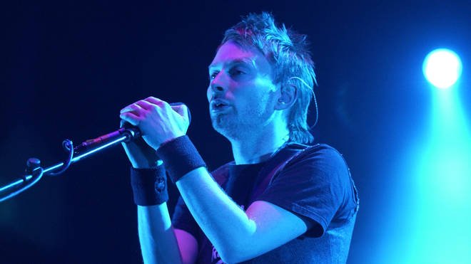 Thom Yorke performing with Radiohead in 2003