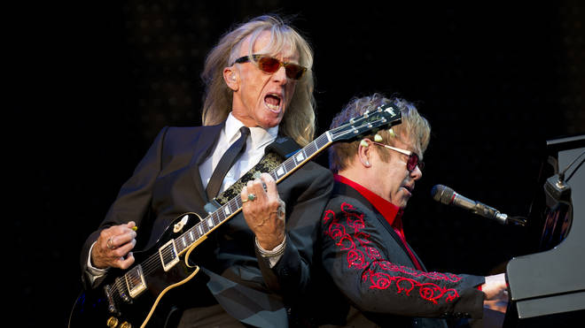 Davey Johnstone perfoms with Elton John onstage in 2012