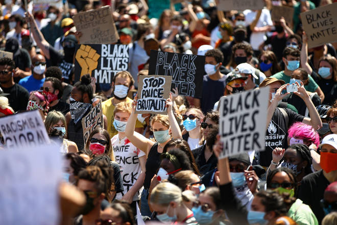 People hold placards as they join a spontaneous Black Lives Matter march at Trafalgar Square to protest the death of George Floyd in Minneapolis and in support of the demonstrations in North America on May 31, 2020 in Londo