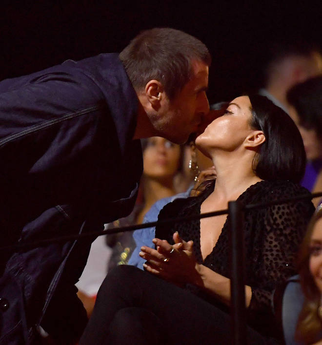 Liam Gallagher kisses Debbie Gwyther at the 2019 MTV EMA's