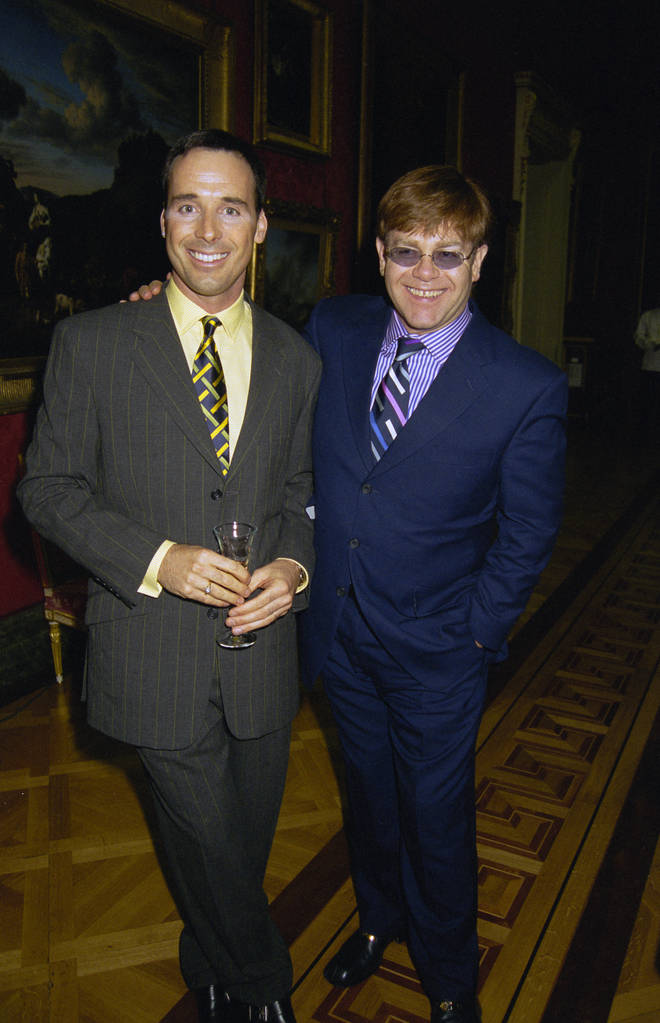 David Furnish and Elton John attend Lord Linley's furniture launch at the Wallace Collection in London, 26th June 1997