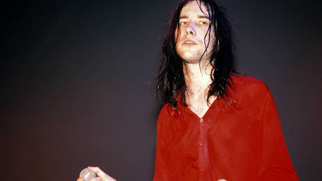 obby Gillespie performing live onstage with Primal Scream
