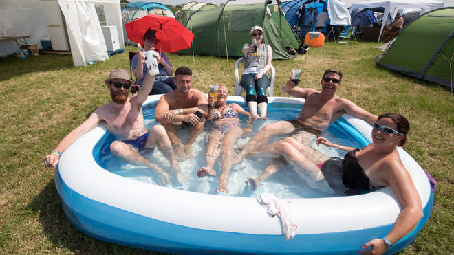 Festival goers take a cool dip on the first day of Glastonbury 2017