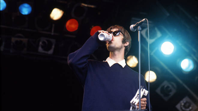 Liam Gallagher of Oasis performs on stage at Glastonbury, 26 June 1994