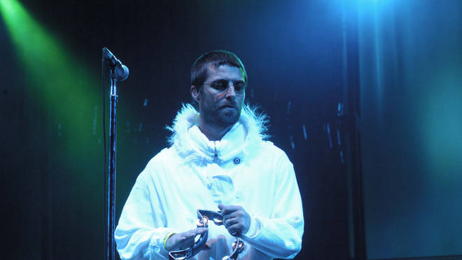 Liam Gallagher performing with Oasis at Glastonbury 2004
