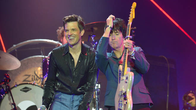 Johnny Marr performs with Brandon Flowers of The Killers at Glastonbury 2019