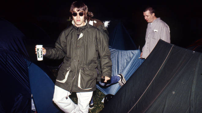 It doesn't matter if your band is headlining the Pyramid Stage, you still have to navigate those guy ropes. Liam Gallagher at Glastonbury 1995