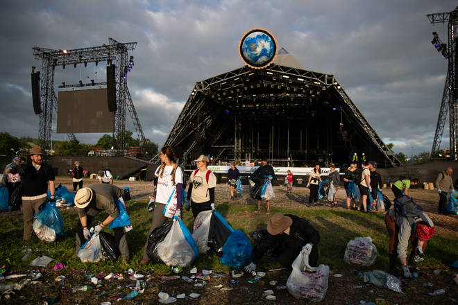 Clean up begins in front of the pyramid stage at the Glastonbury Festival at Worthy Farm in Somerset.