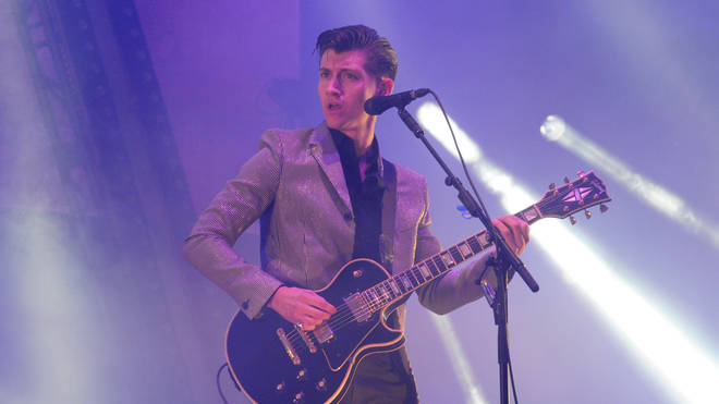 Alex Turner on stage as Arctic Monkeys headline Glastonbury Festival 2013
