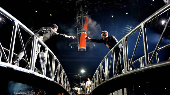 Bono and The Edge exchange gifts as the 360 tour stops off at Denver, Colorado on 21 May 2011.