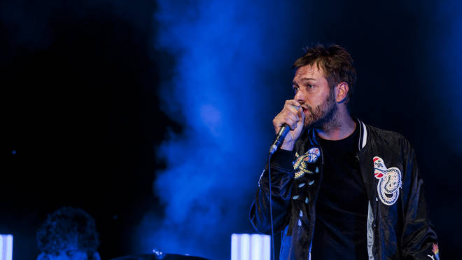Tom Meighan from Kasabian performs in 2018