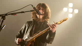 Alex Turner of Arctic Monkeys performing live at Wembley Arena on the 17th November 2009