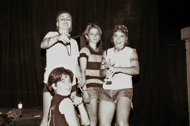 Members of 7 Year Bitch Roisin Dunne, vocalist Selene Vigil, drummer Valerie Agnew and bassist Elizabeth Davis (seated) in 1993