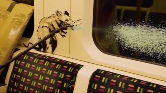 Banksy unveils new artwork on the London Underground which supports mask wearing