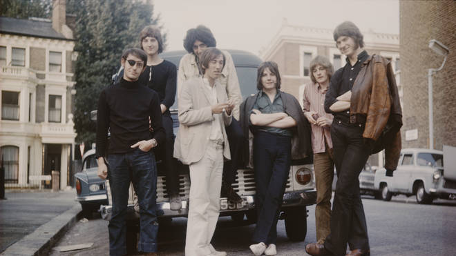 Smile in 1969, before the arriva of Roger Taylor:  Bruce Sanderson (with eye patch), Paul Humbertone, Brian May (sitting on bonnet), Pete Edmunds, Tim Staffell, Clive Armitage and Paul Fielder.