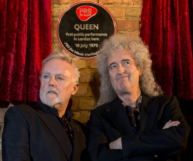 2013: Roger Taylor and Brian May pose with a plaque marking their first public gig at the Imperial College London Student Union on July 18,1970.