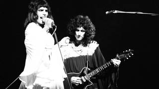 Freddie Mercury and Brian May of Queen perform on stage in London, 1974.