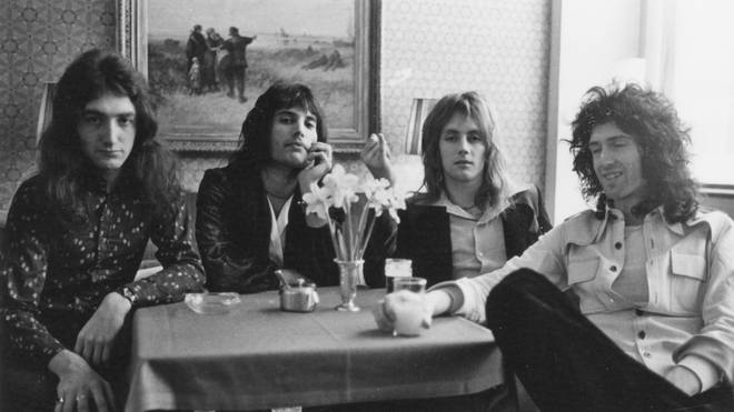 Queen posed in a cafe in the Netherlands on 22nd November 1974: John Deacon, Freddie Mercury, Roger Taylor and Brian May.
