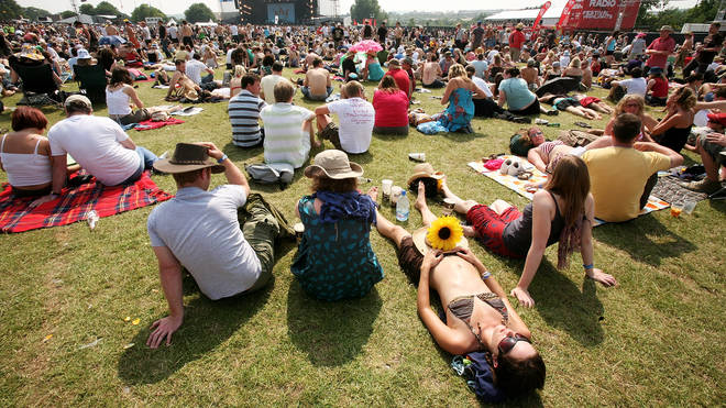 Fans kick back on the second day of the Isle Of Wight festival 2007.