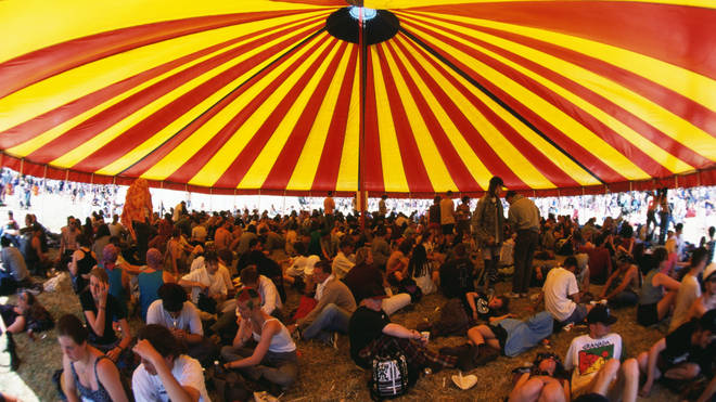 Sheltering under the sun beneath a marquee at Glastonbury 1995.