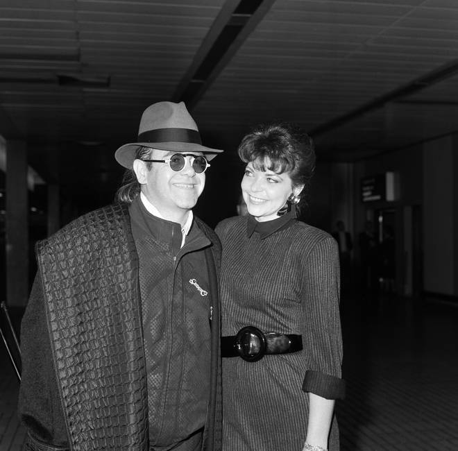 Elton John with his wife Renate arriving from Los Angeles at London Airport, 17th October 1986