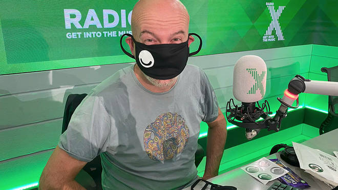 Dominic Byrne  tries on a mask made by a listener on The Chris Moyles Show
