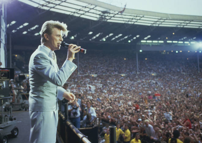 David Bowie performing at the Live Aid concert at Wembley Stadium in London, 13th July 1985. T