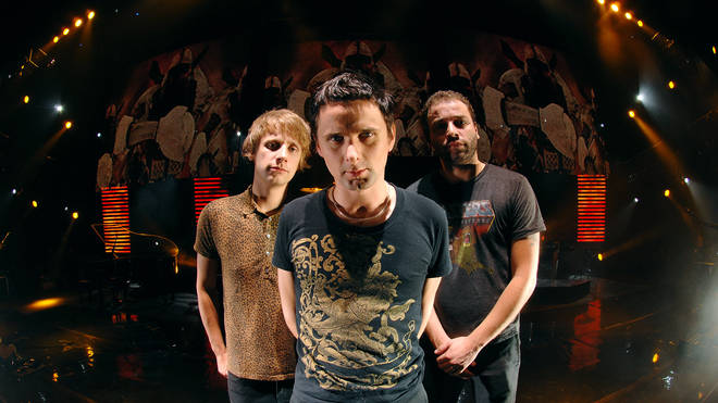 Dominic Howard, Matt Bellamy and Chris Wolstenholme of Muse in 2007