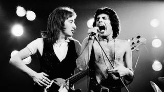 John Deacon and Freddie Mercury onstage at Earls Court, London on 6 June 1977