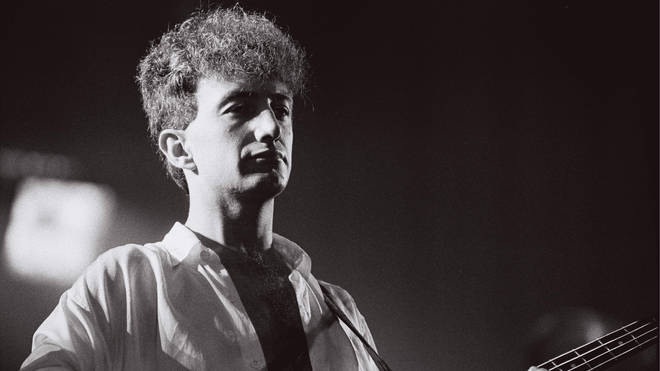 John Deacon performing with Queen during the Works tour in 1984