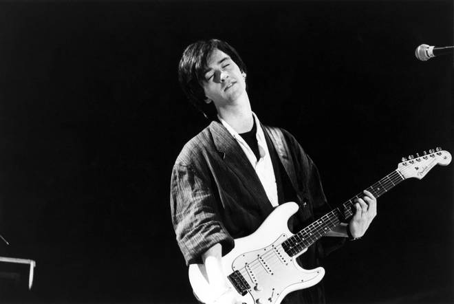 Johnny Marr performing in the heyday of The Smiths.