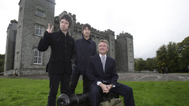 Noel Gallagher and Gem Archer pose with  Lord Henry Mountcharles outside Slane Castle in 2008