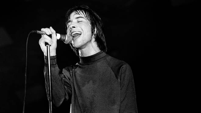 bobby Gillespie performing with Primal Scream in 1990