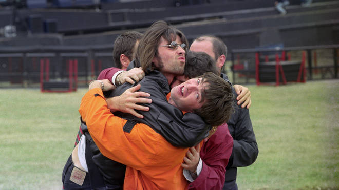 Oasis hug outside Knebworth Park in 1996