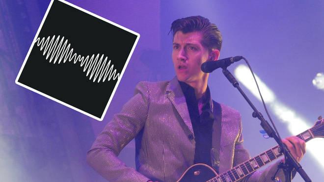 Alex Turner at Glastonbury Festival 2013 with Arctic Monkey's AM album artowork inset