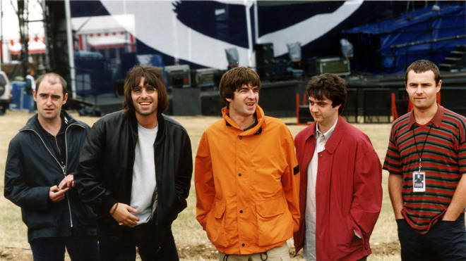Oasis pose before their 1996 Knebworth gig