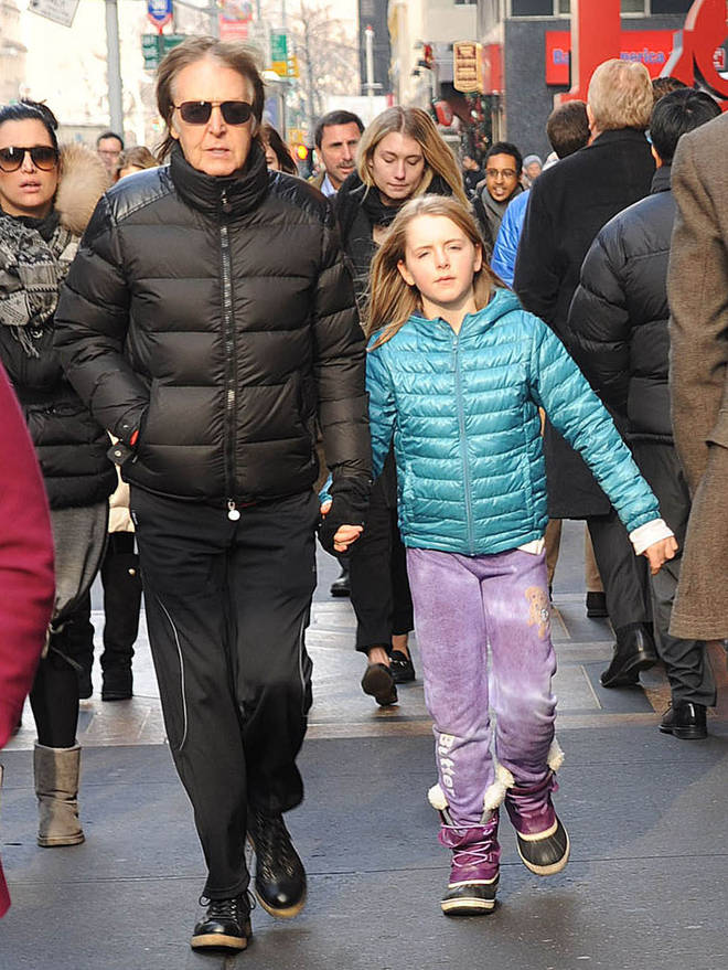 Sir Paul McCartney and his daughter, Beatrice McCartney, are seen on December 19, 2013 in New York City.