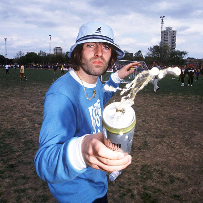 Liam Gallagher Throwing Beer Over A Photographer in 1996