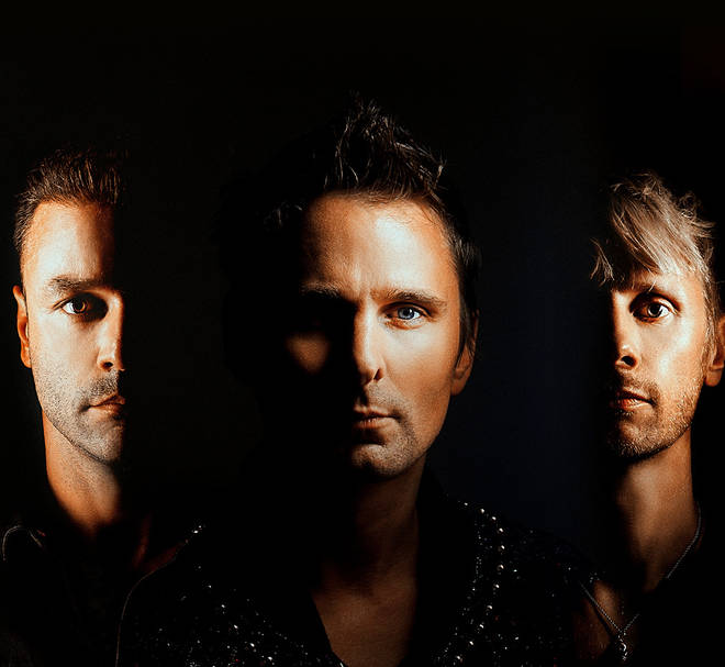 Muse members Chris Wolstenholme, Matt Bellamy and Dominic Howard press image
