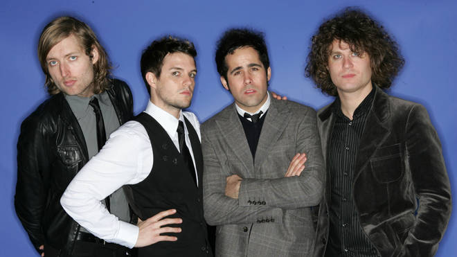 The Killers at the 2004 Billboard Music Awards: Mark Stoermer, Brandon Flowers, Ronnie Vannucci Jr and Dave Keuning.