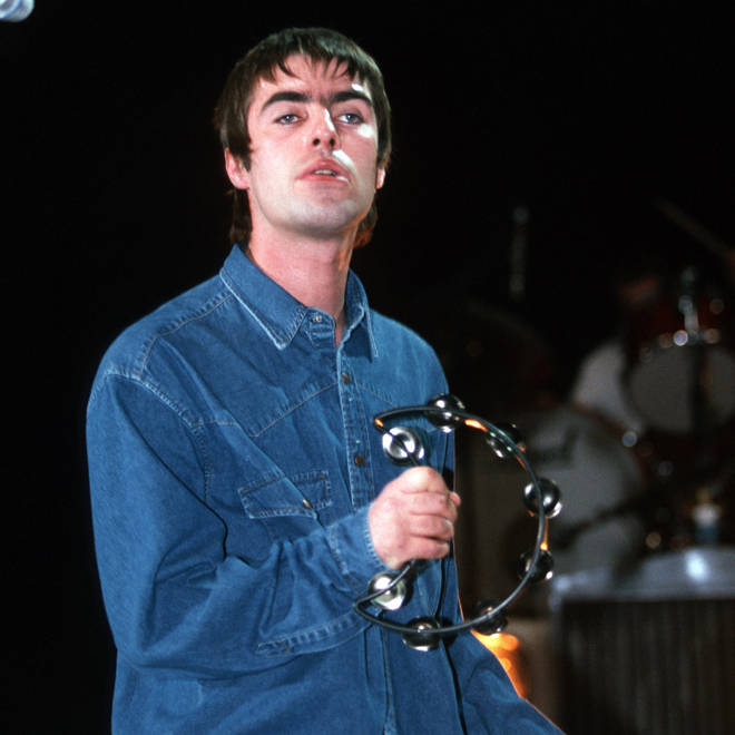 Liam Gallagher onstage with Oasis in 1997
