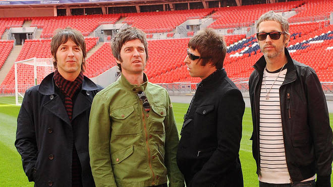 Gem Archer, Noel Gallagher, Liam Gallagher and Andy Bell of Oasis at Wembley in October 2008