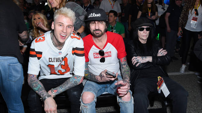 Machine Gun Kelly, Tommy Lee and Mick Mars attend the Monster Energy NASCAR Cup Series race at Auto Club Speedway at Auto Club Speedway on March 17, 2019