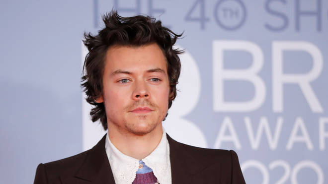 Harry Styles poses on the red carpet on arrival for the BRIT Awards 2020