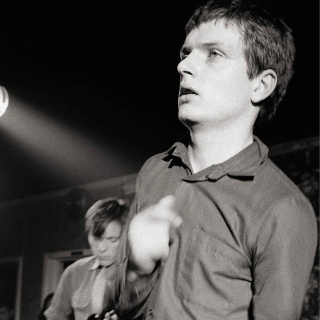 Bernard Sumner and Ian Curtis performing onstage as Joy Division in March 1979