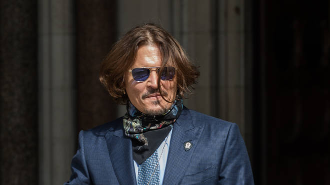 Johnny Depp arrives at the Royal Courts of Justice on day fourteen of the hearing on the libel case against The Sun newspaper on 24 July, 2020